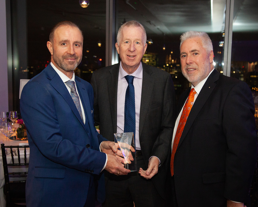 British Institute Freight Association Director General presents Sandford Freight Managing Director Roy Walker and Chairman Sean Sandford with an award recognising 20 years as a freight forwarding company.
